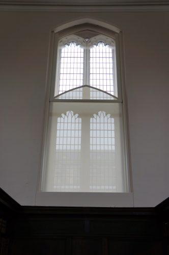 Tension blind on church window.